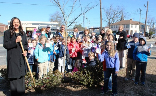 hudge and children planting a tree on courthouse lawn
